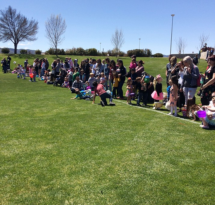 The crowd at the 16th Family Arts Festival and EGGstravaganza on the lawn of the Prescott Valley Civic Center April 13. (Nanci Hutson/Tribune)