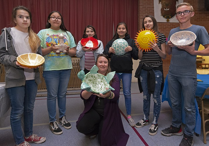 "The Winslow Junior High Art club raised $750 for people subject to hunger in Winslow through its ""Empty Bowls"" art auction. (Todd Roth/NHO)"