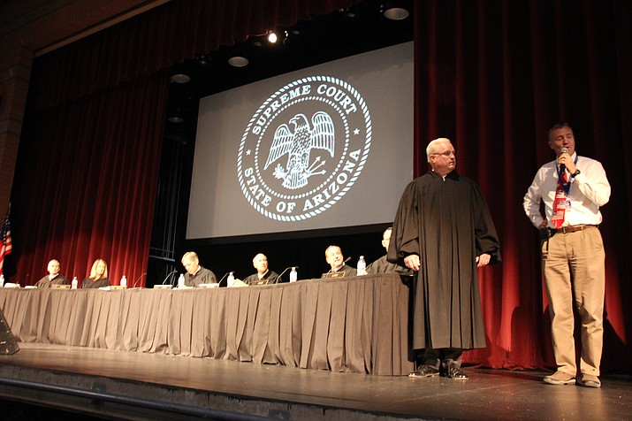 Arizona Supreme Court justices watch as one of their own, Vice Chief Justice Robert Brutinel, is honored by Prescott High School officials during a Supreme Court visit to Prescott on Tuesday, April 16. (Max Efrein/Courier)