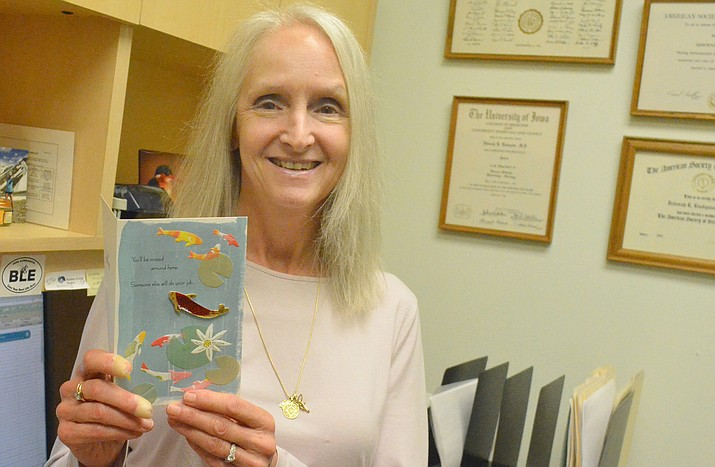 Dr. Deborah Lindquist MD shows one of the cards she has received since announcing her retirement at her Arizona Oncology office in Sedona last week. VVN/Vyto Starinskas
