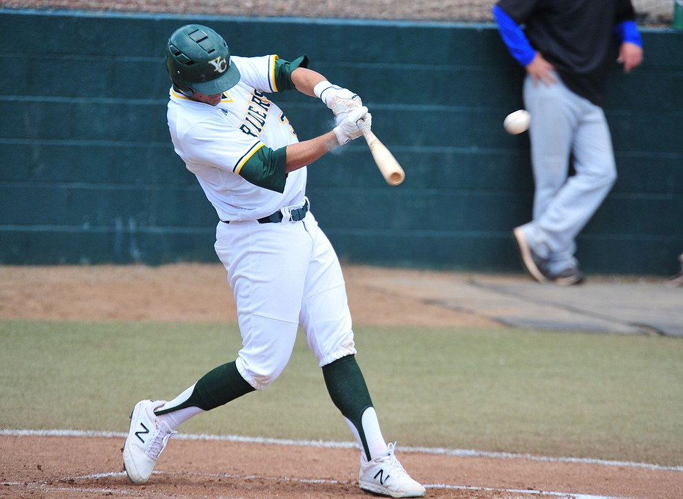 Yavapai's Jack Silverman makes contact as the Roughriders take on Gateway Community College Wednesday, April 17 at in Prescott.  (Les Stukenberg/Courier)