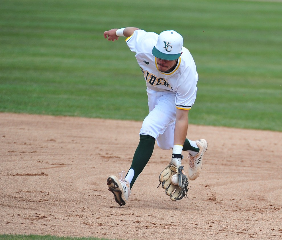 Yavapai's Channy Ortiz chases down a ball at shortstop as the Roughriders take on Gateway Community College Wednesday, April 17 at in Prescott.  (Les Stukenberg/Courier)