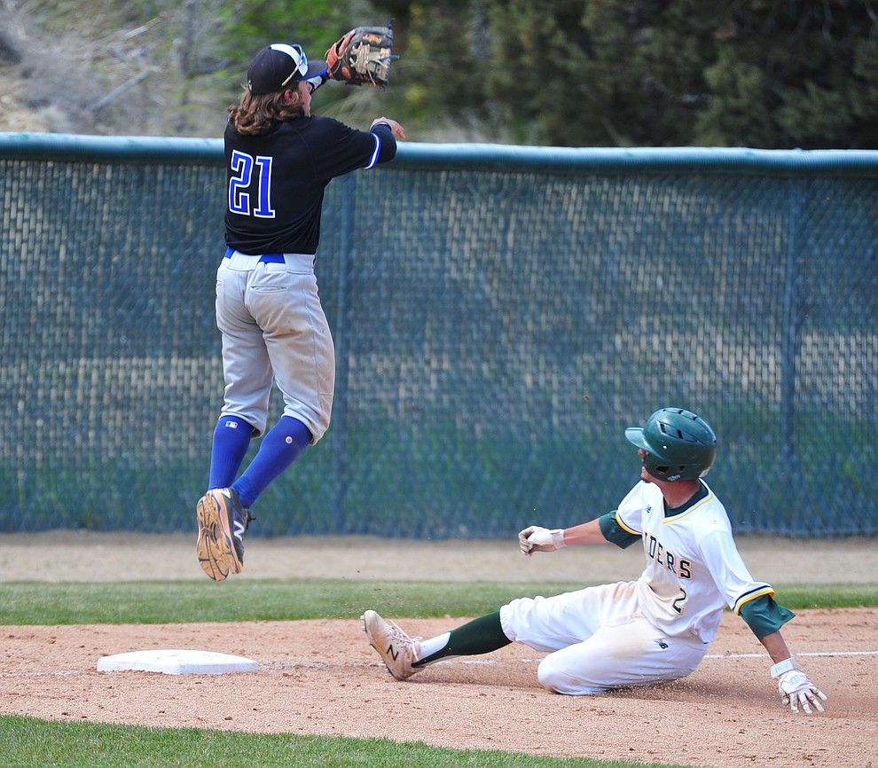 Yavapai's Rocky Botello slides into third as the Roughriders take on Gateway Community College Wednesday, April 17 at in Prescott.  (Les Stukenberg/Courier)