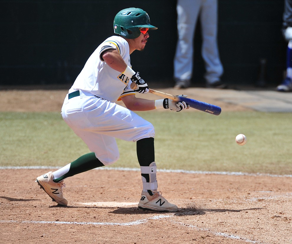 Yavapai's Channy Ortiz lays down a bunt as the Roughriders take on Gateway Community College Wednesday, April 17 at in Prescott.  (Les Stukenberg/Courier)