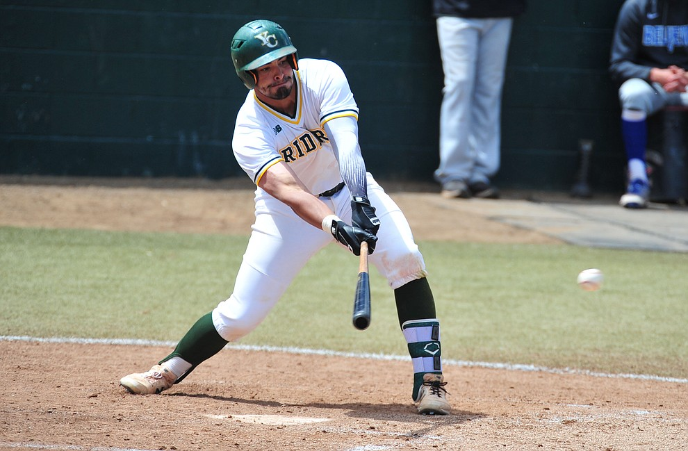 Yavapai's Christian Encarnacion-Strand makes contact for a single as the Roughriders take on Gateway Community College Wednesday, April 17 at in Prescott.  (Les Stukenberg/Courier)
