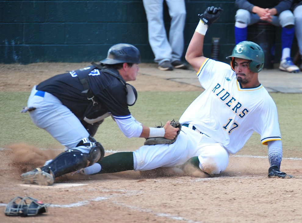 Yavapai's Christian Encarnacion-Strand gets tagged out at home as the Roughriders take on Gateway Community College Wednesday, April 17 at in Prescott.  (Les Stukenberg/Courier)