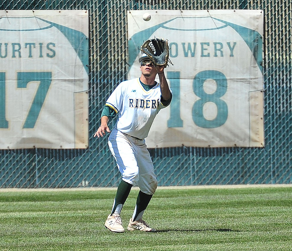 Yavapai's Rocky Botello makes the catch in left field as the Roughriders take on Gateway Community College Wednesday, April 17 at in Prescott.  (Les Stukenberg/Courier)