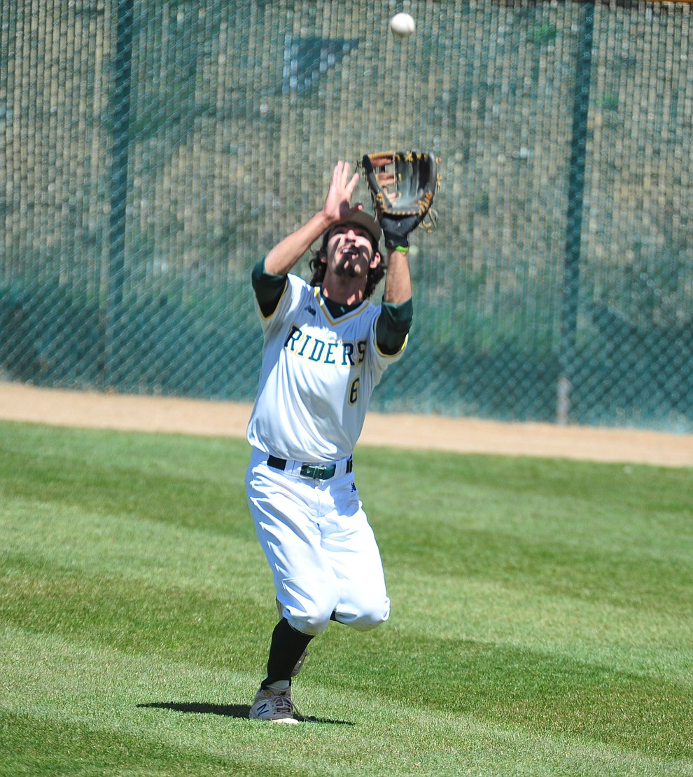 Yavapai's Matt Novis makes the catch in right field as the Roughriders take on Gateway Community College Wednesday, April 17 at in Prescott.  (Les Stukenberg/Courier)