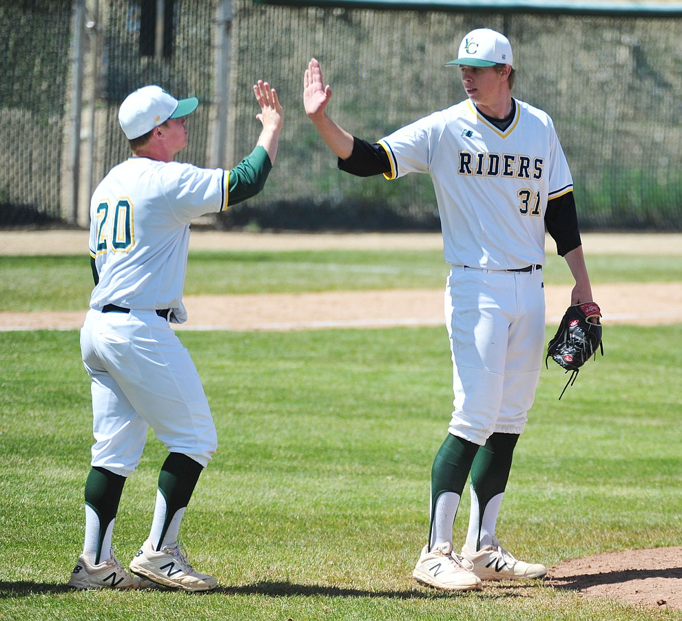 Yavapai's Sasha Sneider, left, congratulates Trey Morrill on his complete game win as the Roughriders take on Gateway Community College Wednesday, April 17 at in Prescott.  (Les Stukenberg/Courier)