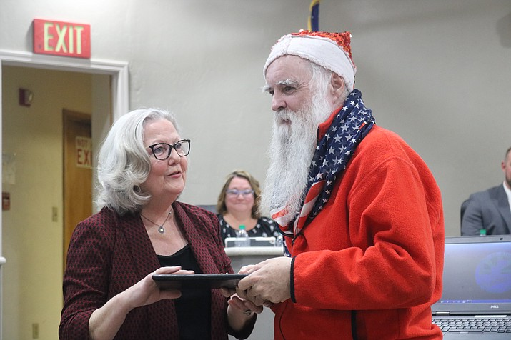 "Mayor Jen Miles presents ""Santa"" James Zyla with a Key to the City and Kingman's first Unity Award at Tuesday's Council meeting. (Photo by Travis Rains/Daily Miner)"
