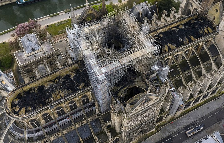 An image made available by Gigarama.ru on Wednesday April 17, 2019, shows an aerial shot of the fire damage to Notre Dame cathedral in Paris on Tuesday April 16. Nearly $1 billion has already poured in from ordinary worshippers and high-powered magnates around the world to restore Notre Dame Cathedral in Paris after it was damaged in a massive fire on Monday. (Gigarama.ru via AP)