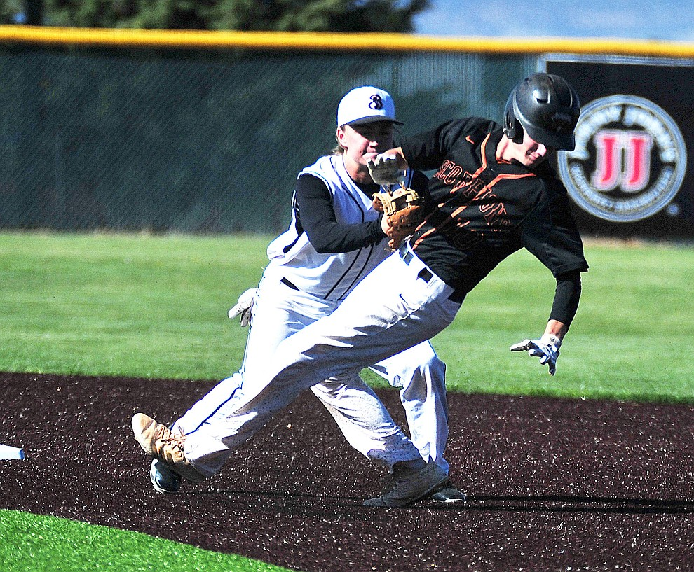 Bradshaw Mountain's Chase Torp tags out a runner as the Bears face Desert Edge Thursday, April 18 in Prescott Valley.  (Les Stukenberg/Courier)