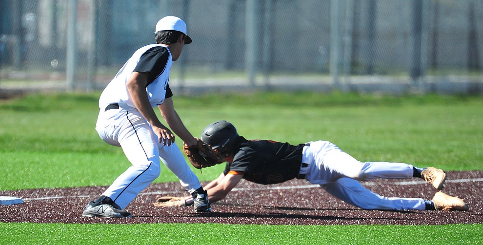 Bradshaw Mountain's Aidaan Garcia gets the tag at third as the Bears face Desert Edge Thursday, April 18 in Prescott Valley.  (Les Stukenberg/Courier)