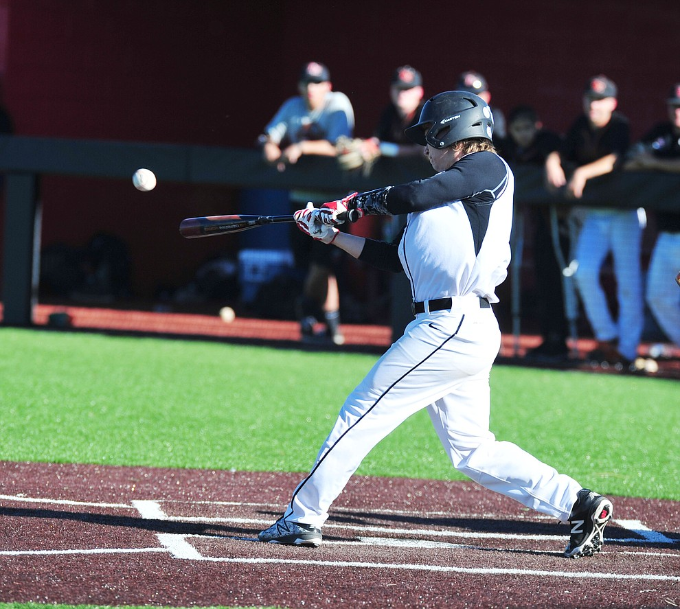 Bradshaw Mountain's Chase Torp singles as the Bears face Desert Edge Thursday, April 18 in Prescott Valley.  (Les Stukenberg/Courier)
