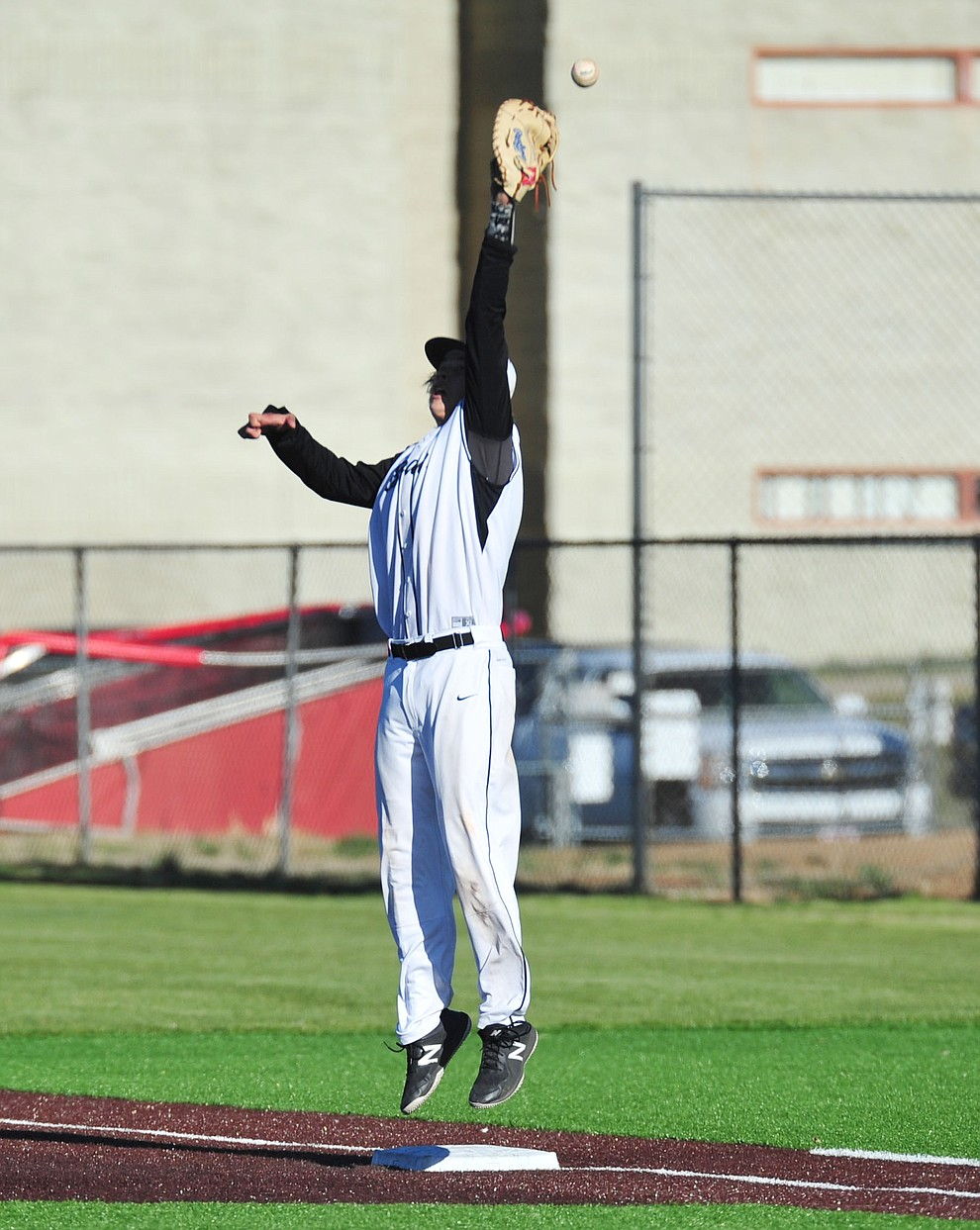 Bradshaw Mountain's Dane Holloway goes high for a throw as the Bears face Desert Edge Thursday, April 18 in Prescott Valley.  (Les Stukenberg/Courier)