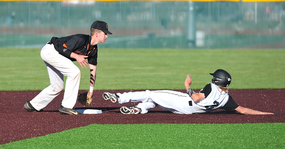 Bradshaw Mountain's Jacob Platt slides safely into second as the Bears face Desert Edge Thursday, April 18 in Prescott Valley.  (Les Stukenberg/Courier)