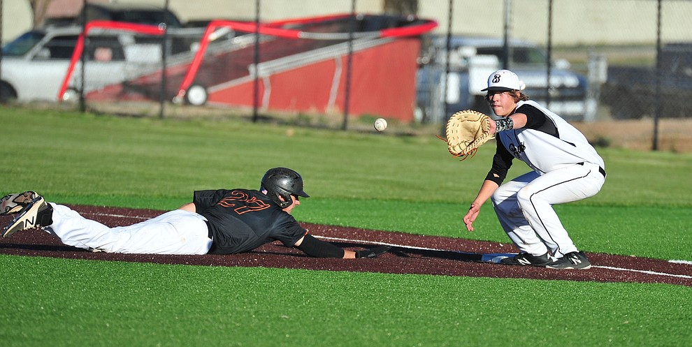 Bradshaw Mountain's Dane Holloway tires to get a runner at first as the Bears face Desert Edge Thursday, April 18 in Prescott Valley.  (Les Stukenberg/Courier)