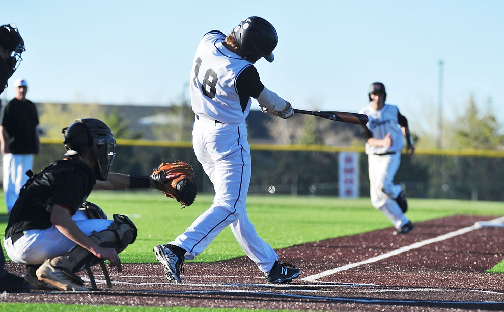 Bradshaw Mountain's Josh Grant hits a long triple to the gap as the Bears face Desert Edge Thursday, April 18 in Prescott Valley.  (Les Stukenberg/Courier)