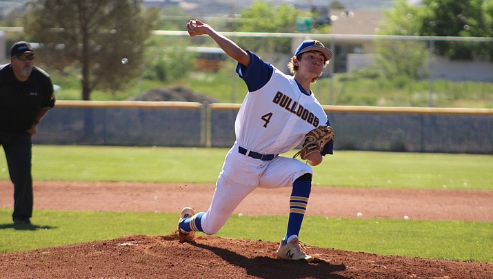 Kingman senior Luke Ness tossed a three-hitter with 12 strikeouts and one walk Thursday to help propel the Bulldogs to a 3-1 victory over Wickenburg. (Photo by Beau Bearden/Daily Miner)