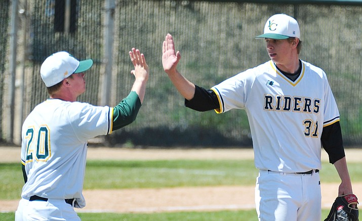 Yavapai's Sasha Sneider, left, congratulates Trey Morrill on his complete game win as the Roughriders take on Gateway Community College Wednesday, April 17, in Prescott.  (Les Stukenberg/Courier)