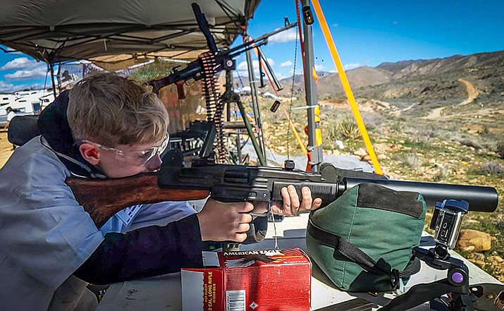 A young marksman takes aim at Big Sandy Range. The range, located 40 miles southeast of Kingman, has been home for arms traders demonstrating their wares. (Photo courtesy MG Shooters)