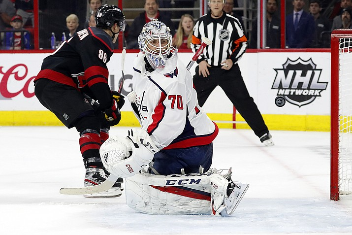 Washington Capitals goaltender Braden Holtby (70) looks back at the puck after Carolina Hurricanes' Teuvo Teravainen (86), of Finland, scored during the second period of Game 4 of an NHL hockey first-round playoff series in Raleigh, N.C, Thursday, April 18, 2019, (Karl B DeBlaker/AP)