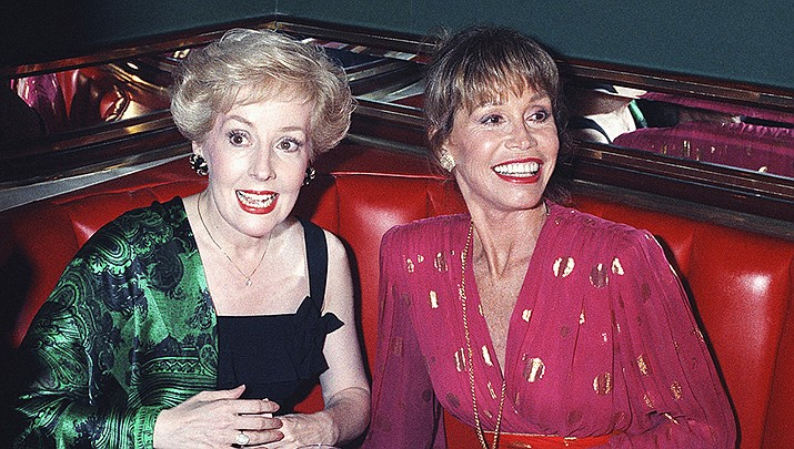 """In this Aug. 30, 1992, file photo, Mary Tyler Moore, right, is joined by former """"Mary Tyler Moore Show"""" co-star Georgia Engel, left, who played Georgette, at New York's Russian Tea Room, as the two reunited during an Emmy Awards screening party Moore hosted at the famous New York restaurant. Engel died Friday, April 12, 2019, in Princeton, N.J., at age 70. (Malcolm Clarke/AP, File)"""