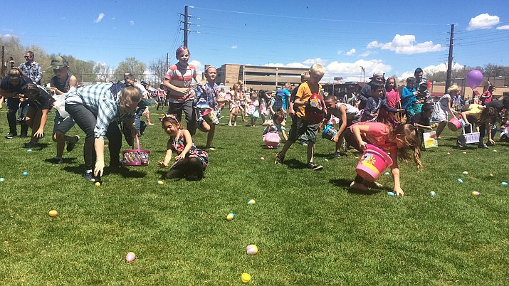 Kids scramble to find eggs at the Great Prescott Easter Egg Hunt on Saturday, April 20, 2019. (Jason Wheeler/Courier)