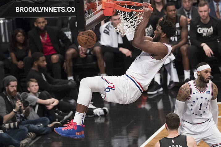 Philadelphia 76ers center Joel Embiid dunks during the second half of Game 4 of a first-round NBA basketball playoff series against the Brooklyn Nets, Saturday, April 20, 2019, in New York. (Mary Altaffer/AP)