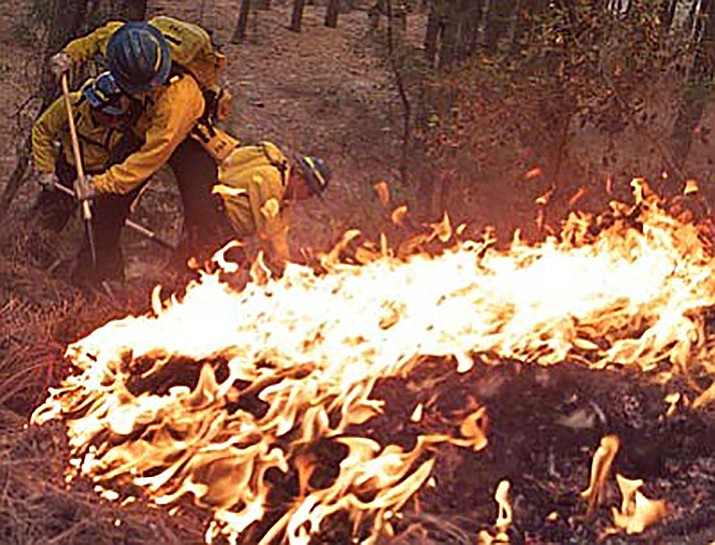 Firefighters work furiously to get a line around the Indian Fire throughout the night after it erupted on May 15, 2002. (Courier file)