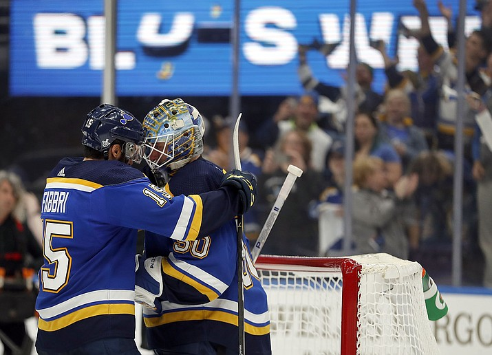 St. Louis Blues' Robby Fabbri, left, and goaltender Jordan Binnington celebrate after defeating Winnipeg in Game 6 of an NHL first-round playoff series, Saturday, April 20, 2019, in St. Louis. (Jeff Roberson/AP)