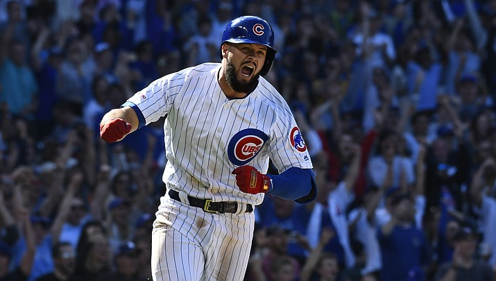 Chicago Cubs' David Bote (13) reacts after hitting a walk off single during the ninth inning of a baseball game against the Arizona Diamondbacks Sunday, April 21, 2019, in Chicago. (Matt Marton/AP)