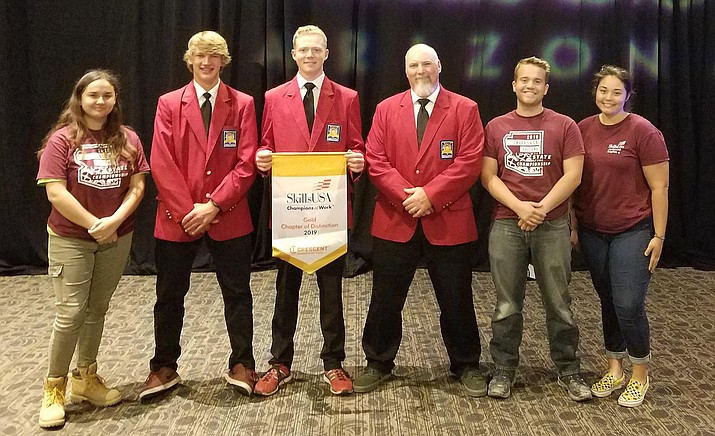 Valley Academy's construction club, pictured with advisor and construction instructor Travis Black, are recognized at the April 12 SkillsUSA competition in Phoenix. Photo courtesy Valley Academy of Career and Technology Education