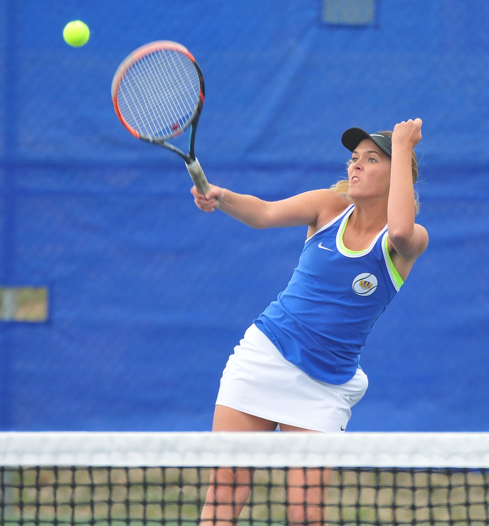Prescott's Abby Stoecker hits a serve as the Badgers play Ironwood Ridge in the first round of the Arizona Interscholastic Association State Team Tennis Tournament Tuesday, April 23 in Prescott.  (Les Stukenberg/Courier)
