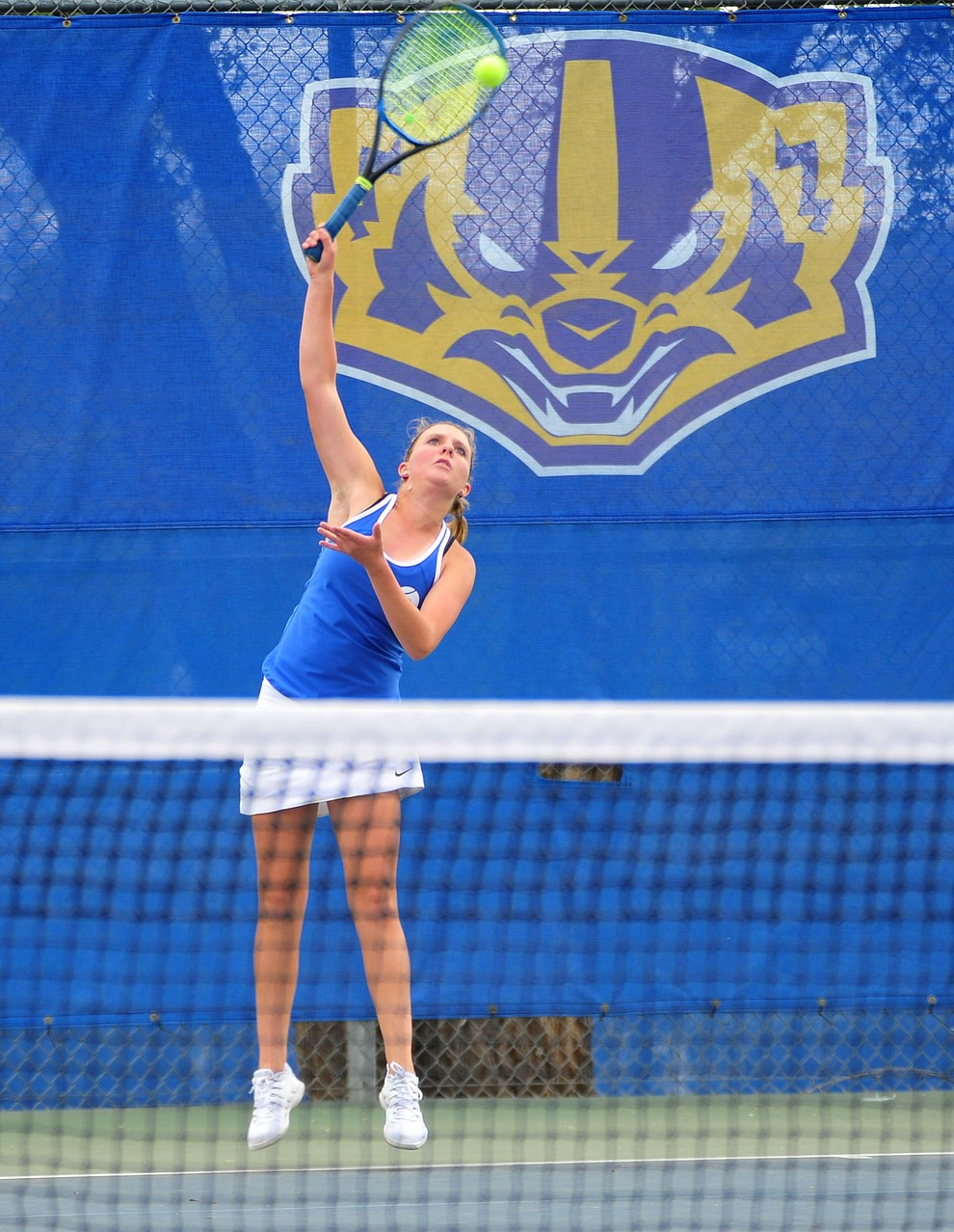 Prescott's Ava Andrews hits a serve as the Badgers play Ironwood Ridge in the first round of the Arizona Interscholastic Association State Team Tennis Tournament Tuesday, April 23 in Prescott.  (Les Stukenberg/Courier)