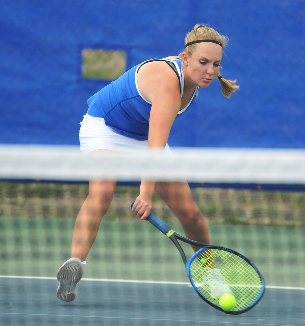 Prescott's Ava Andrews hits a return shot as the Badgers play Ironwood Ridge in the first round of the Arizona Interscholastic Association State Team Tennis Tournament Tuesday, April 23 in Prescott.  (Les Stukenberg/Courier)