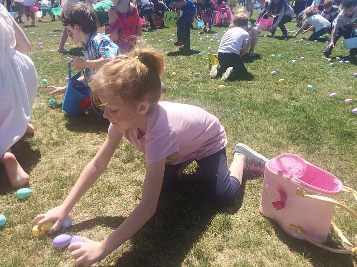 Darletta Haverstock reaches for some eggs at the annual Free Easter Egg Hunt at the Chino Valley Community Center Ball Fields Saturday, April 20. (Jason Wheeler/Review)