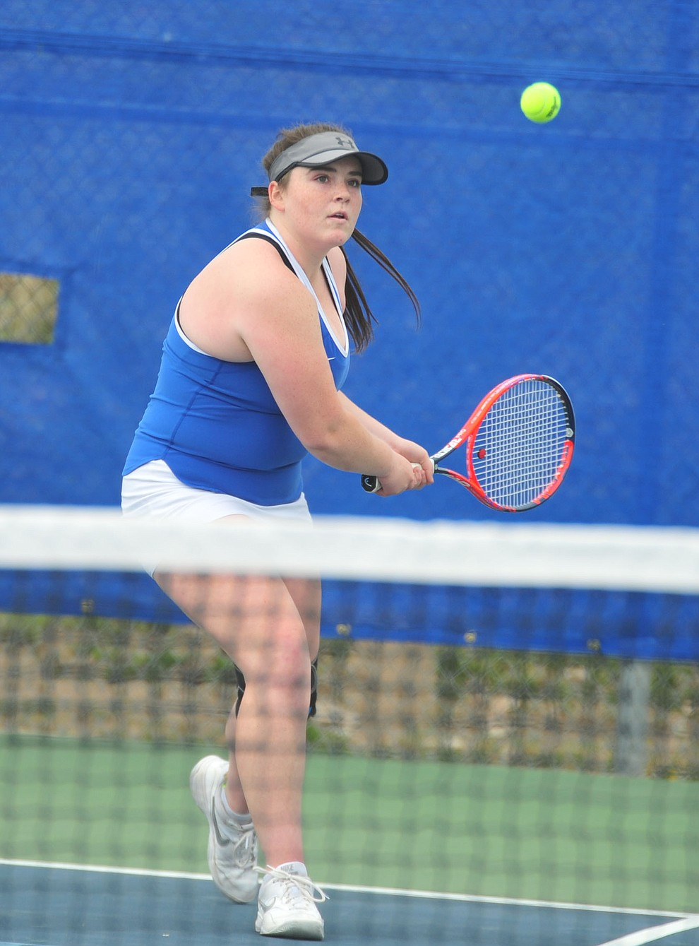 Prescott's Ellie Fenderson hits a return shot as the Badgers play Ironwood Ridge in the first round of the Arizona Interscholastic Association State Team Tennis Tournament Tuesday, April 23 in Prescott.  (Les Stukenberg/Courier)