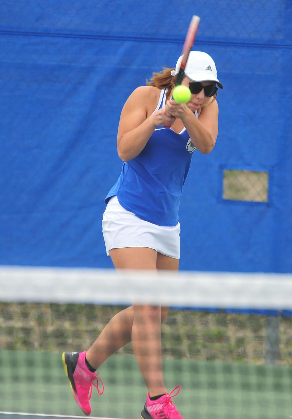 Prescott's Heidi Madsen hits a return shot as the Badgers play Ironwood Ridge in the first round of the Arizona Interscholastic Association State Team Tennis Tournament Tuesday, April 23 in Prescott.  (Les Stukenberg/Courier)