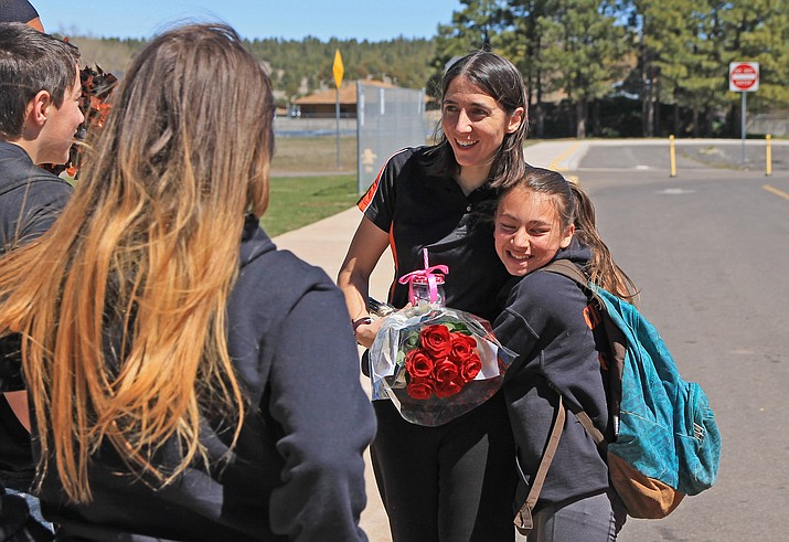 WUSD teacher Beverly Stearns is greeted by Reina Rocha and other students at Williams Elementary-Middle School April 18 following her selection as the 2019 Coconino County Teacher of the Year. (Wendy Howell/WGCN