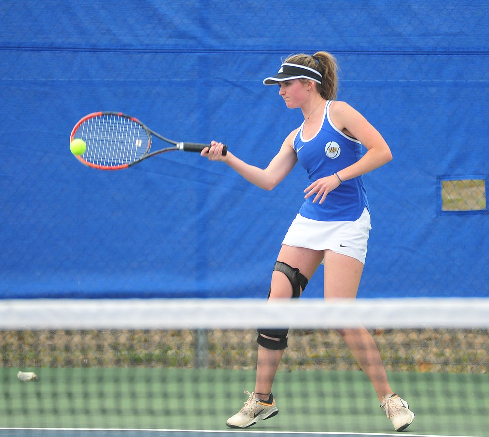 Prescott's Riley Smith hits a return shot as the Badgers play Ironwood Ridge in the first round of the Arizona Interscholastic Association State Team Tennis Tournament Tuesday, April 23 in Prescott.  (Les Stukenberg/Courier)