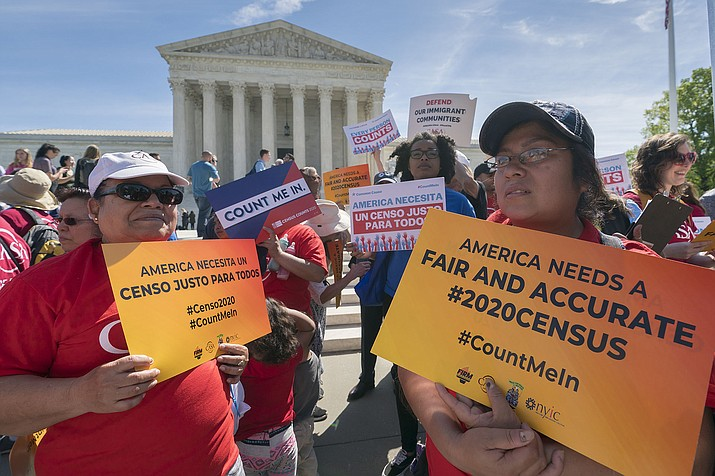 Immigration activists rally outside the Supreme Court as the justices hear arguments over the Trump administration's plan to ask about citizenship on the 2020 census, in Washington, Tuesday, April 23, 2019. (J. Scott Applewhite/AP)