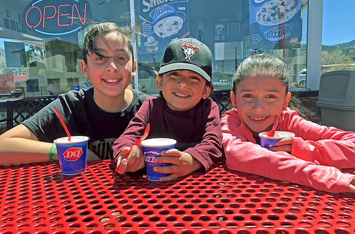 Gia (12), Gianni ( 5) and Giselle (7) Valerio of Williams enjoy Blizzards at Dairy Queen April 19. The Dairy Queen on Route 66 is now open for the season, serving tourists and locals ice cream, burgers, fries and more. (Wendy Howell/WGCN)