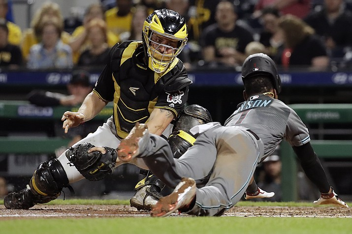 Pittsburgh Pirates catcher Francisco Cervelli, left, can't get the tag on Arizona Diamondbacks' Jarrod Dyson who scores from third on a fielder's choice by David Peralta in the sixth inning of a baseball game in Pittsburgh, Tuesday, April 23, 2019. (Gene J. Puskar/AP)