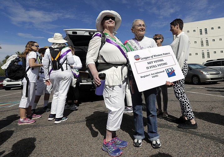 Demonstrators Molly Divine, left, and Rivko Knox pose for a photo before the start of a three-day march in support of ratification of the Equal Right Amendment (ERA) Monday, March 11, 2019, in Phoenix. (Elaine Thompson/AP, file)