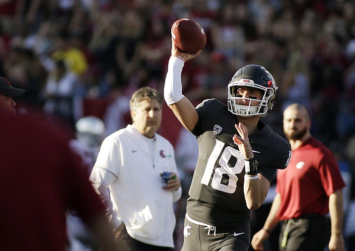 In this Saturday, Oct. 20, 2018, file photo, Washington State quarterback Anthony Gordon (18) throws a pass while warming up before an NCAA college football game against Oregon in Pullman, Wash. Washington State has a spirited quarterback competition involving a large group of would-be starters, including seniors Gordon and Trey Tinsley, Cammon Cooper, graduate transfer Gage Gubrud and sophomore John Bledsoe. (Young Kwak/AP, file)