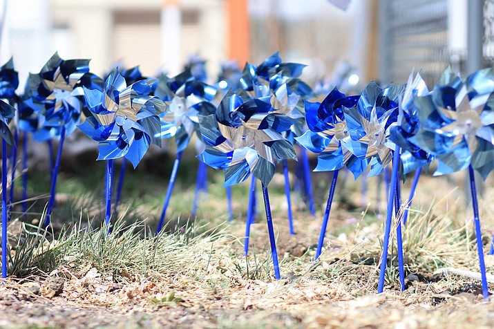 Pinwheels outside North Country HealthCare in Williams help bring awareness of children who died from abuse in Arizona in 2017. (Wendy Howell/WGCN)