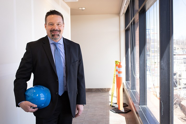 Yavapai Regional Medical Center President and Chief Executive Officer John Amos with a hard hat overseeing current construction on westside campus. (YRMC/Courtesy)