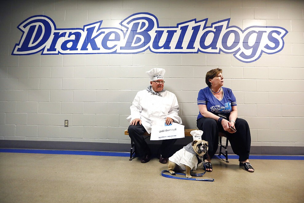 Joe and Mary Bertogli, of Des Moines, Iowa, sit with their dog Gigi before judging at the 40th annual Drake Relays Beautiful Bulldog Contest, Monday, April 22, 2019, in Des Moines, Iowa. The pageant kicks off the Drake Relays festivities at Drake University, where a bulldog is the mascot. (AP Photo/Charlie Neibergall)