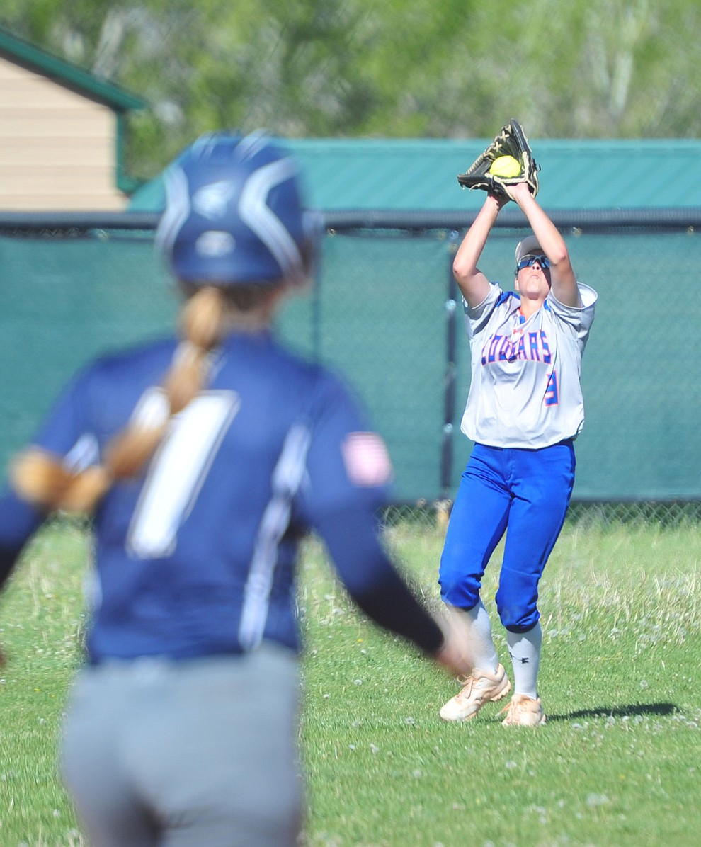 Chino Valley's LeeAnn Llewellyn makes the catch in right field as the Cougars play Pusch Ridge in the play-in round of the Arizona Interscholastic Association State Softball D3 Tournament Wednesday, April 24 in Chino Valley.  (Les Stukenberg/Courier)